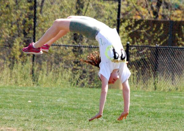 Nudist junior gymnastics handstands